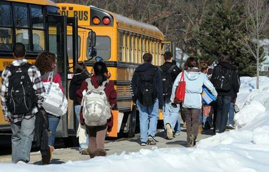 Cold weather. Bus riders at the end of the school day at North Haven High School. Photo by Mara Lavitt/New Haven Register1/24/11