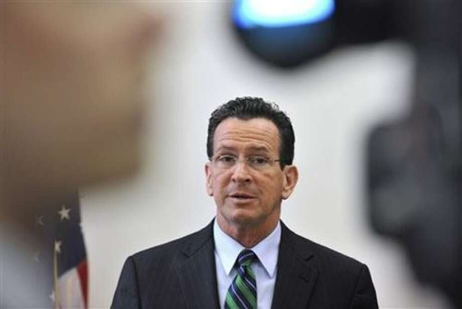 Connecticut Gov. Dannel P. Malloy holds his first news conference as governor in his office at the Capitol in Hartford, Conn., Thursday, Jan. 6, 2011. (AP Photo/Jessica Hill) Photo: AP / AP2011