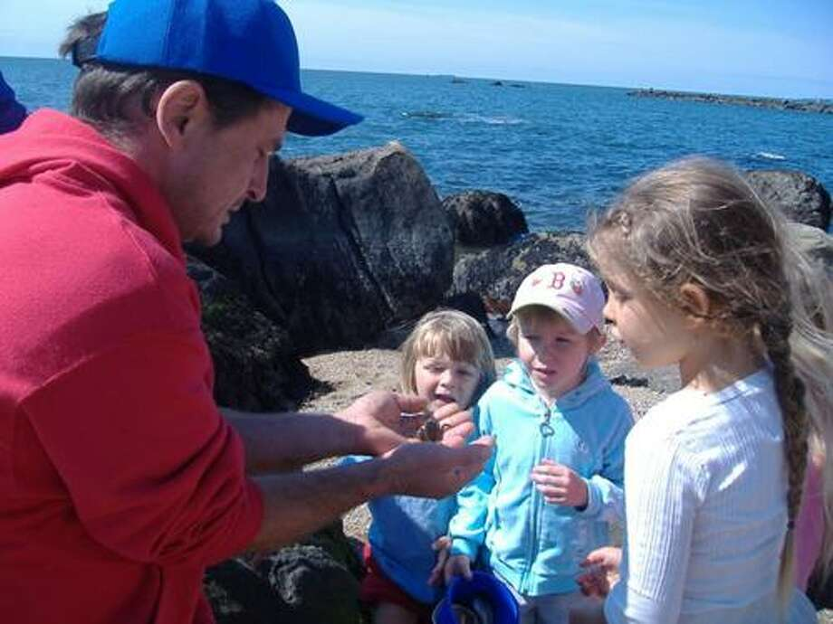 Parent Shane Grant (with live crab) and The Learning Collective students Jackson Virtue, Kai Milewski-Mason and Isabella Trowbridge-Wheeler at Hammonasset State Park in Madison.