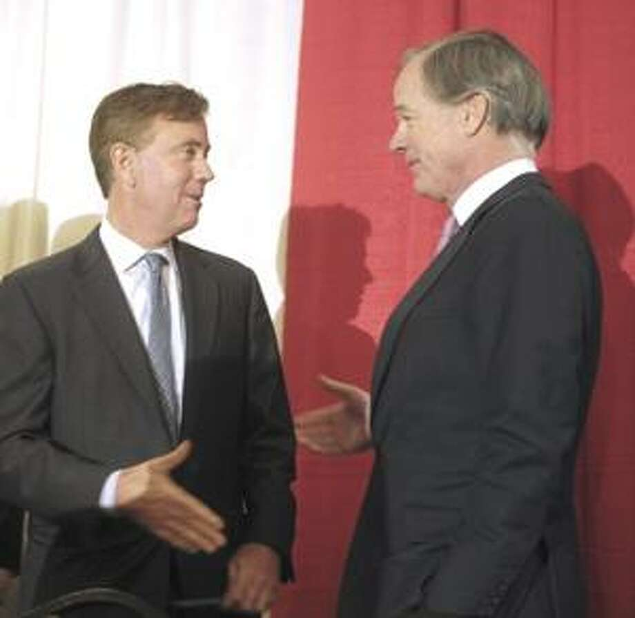 Democratic candidate and former U.S. Senate candidate Ned Lamont, left, reaches to shake hands with Republican candidate and former U.S. Ambassador Tom Foley, right, before a forum in Cromwell, Conn., Wednesday,  Jan. 20, 2010.  Seven candidates appeared Wednesday at the first bipartisan forum of the 2010 governor's race. (AP Photo/Jessica Hill) Photo: AP / FR125654 AP