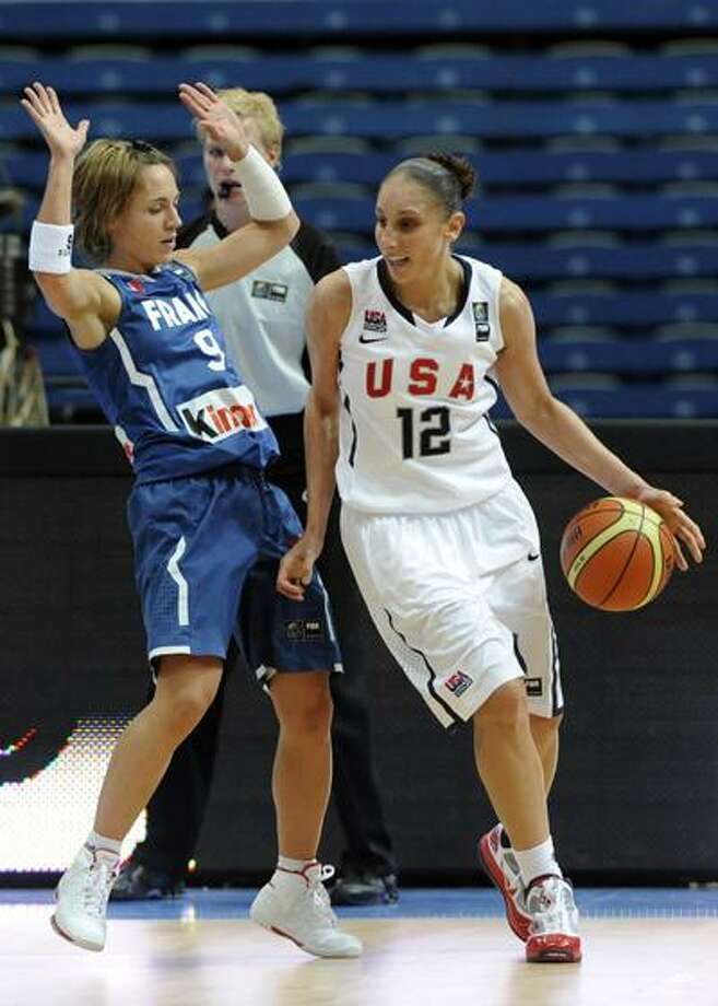 Marion Laborde of the United States, right, plays the ball as Celine Dumerc of France, left, tries to stop her during during their World Basketball Championship preliminary round match between US and France in Ostrava, Czech Republic, on Saturday. (AP) Photo: AP / CTK