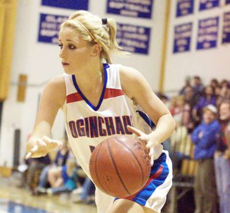 Coginchaug's Audrey Biesak drives to the hoop in a Dec. 17 game against Morgan. Biesak scored 15 points Thursday night against East Hampton in the Blue Devils' 50-38 win. (Edward Gaug / Special to the Press)
