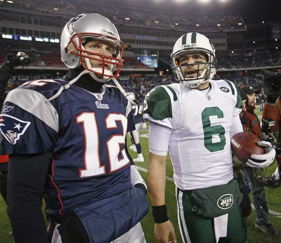 New England Patriots quarterback Tom Brady (12) and New York Jets quarterback Mark Sanchez (6) leave  the field after the Jets beat the Patriots 28-21 in an NFL divisional playoff football game in Foxborough, Mass., Sunday, Jan. 16, 2011. (AP Photo/Stephan Savoia)