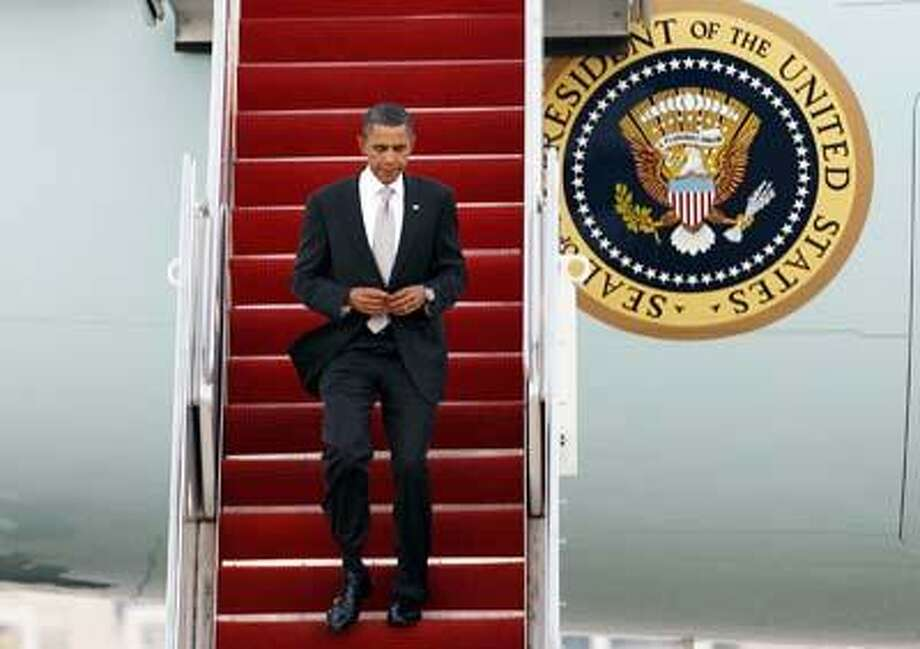 President Barack Obama walks down the stairs from Air Force One upon his arrival at Andrews Air Force Base, Md. on Friday, Sept. 24. (AP) Photo: AP / FR159526 AP