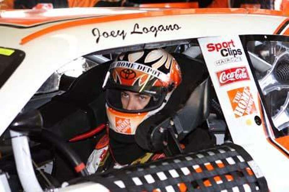 Joey Logano in the garage at the New Hampshire Cup race last summer. (Phil Maddalena / Special to the Press)