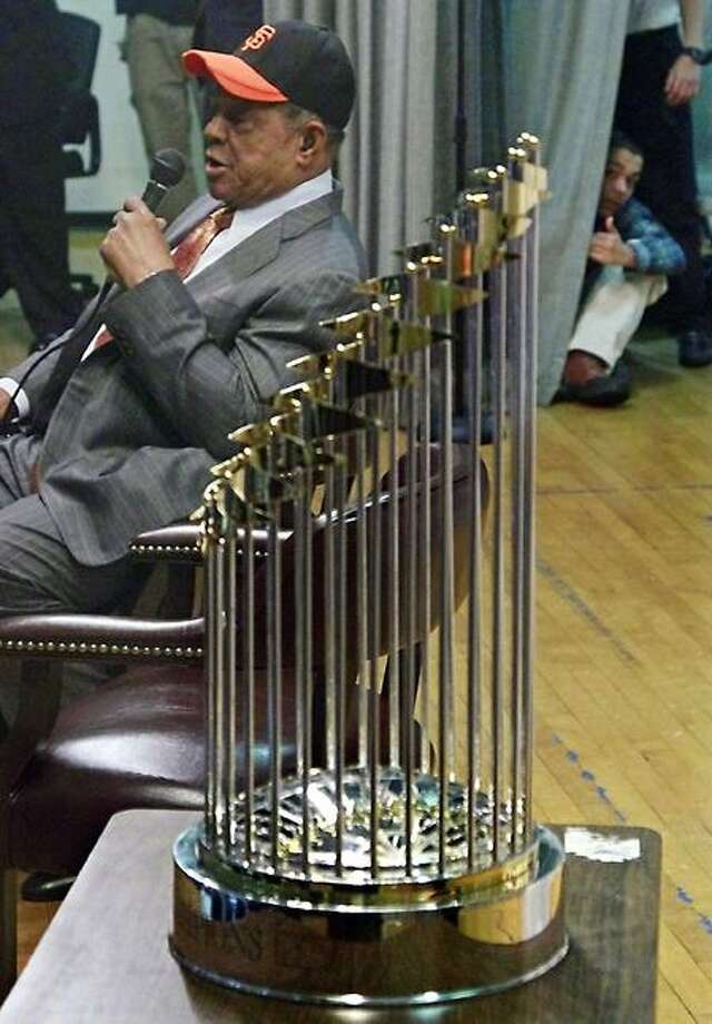 "Willie Mays, former major league baseball player whose greatness spanned both coasts as a Giants, speak during the San Francisco Giants'  2010 World Series trophy display tour event on Friday, Jan. 21, 2011 at the Arthur Tappan School P.S. 46 in Harlem, New York.  The school is near the Polo Grounds, where Mays made his famous catch, simply called ""The Catch,"" to help the Giants win the 1954 World Series against the Cleveland Indians.  The Giants and Mays moved to San Francisco in 1957.  (AP Photo/Bebeto Matthews)"