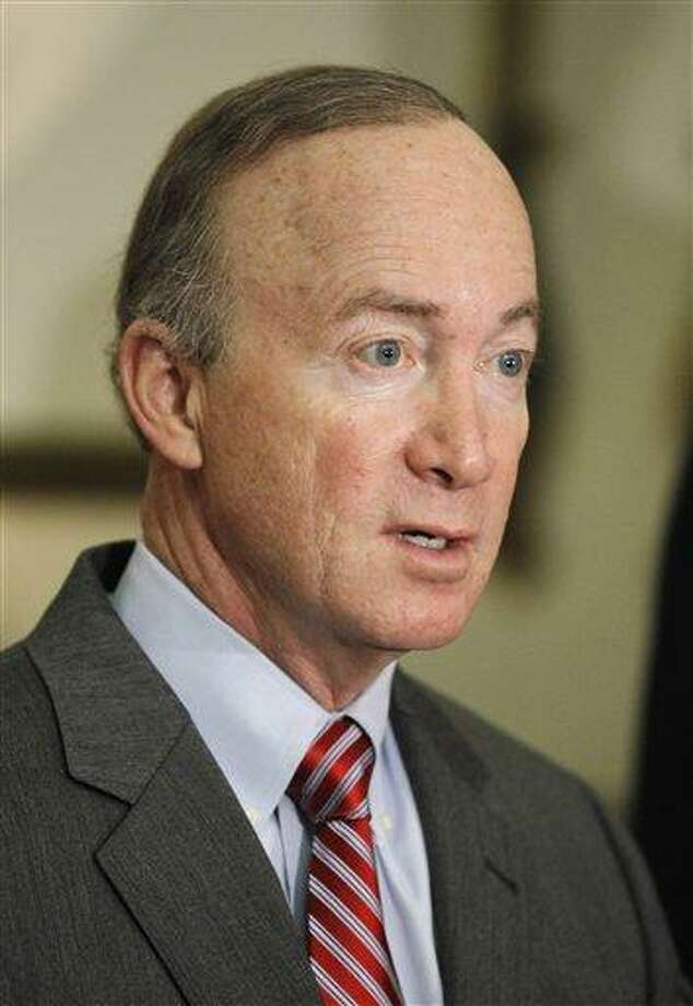FILE - Indiana Gov. Mitch Daniels talks about the improved state revenue forecast during a news conference at the Statehouse in Indianapolis, in this April 15, 2011 file photo. In a middle-of-the-night message on Sunday May 22, 2011, Daniels said he was taking the advice of his family and would skip a White House bid in 2012. (AP Photo/Darron Cummings, File) Photo: AP / AP2011