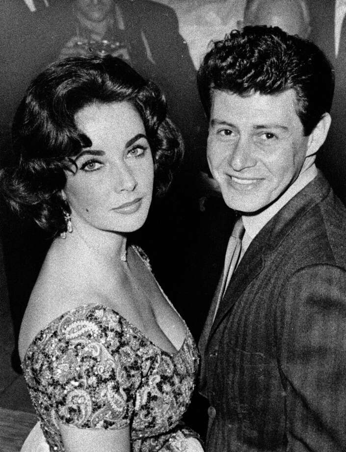 FILE - In this 1959 file photo, actress Elizabeth Taylor is seen with singer Eddie Fisher before their marriage. Fisher, whose huge fame as a pop singer was overshadowed by scandals ending his marriages to Debbie Reynolds and Elizabeth Taylor, died Wednesday night Sept. 22, 2010 of complications from hip surgery at a hospital in Berkeley. He was 85.  (AP Photo/File) Photo: ASSOCIATED PRESS / AP