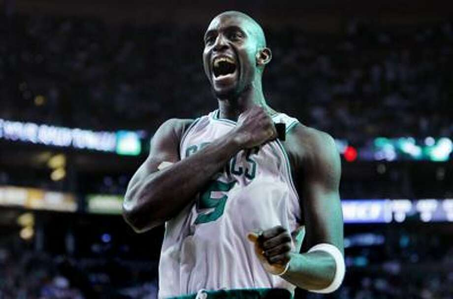 Boston Celtics forward Kevin Garnett pounds his chest as he heads to the floor to face the Orlando Magic in Game 3 of the NBA Eastern Conference basketball finals in Boston, Saturday. (AP) Photo: AP / AP