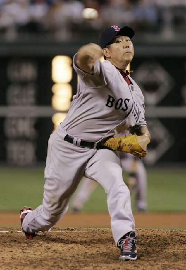 Boston Red Sox starting pitcher Daisuke Matsuzaka works in the eighth inning of an interleague baseball game with the Philadelphia Phillies, Saturday, May 22, 2010, in Philadelphia. The Red Sox won 5-0. (AP) Photo: AP / FR148949 AP