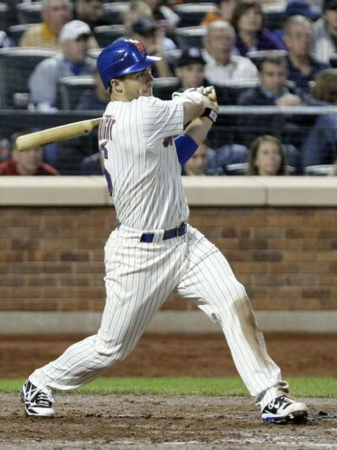New York Mets' David Wright follows through on an RBI single during the third inning of an interleague baseball game against the New York Yankees on Saturday. (AP) Photo: AP / AP