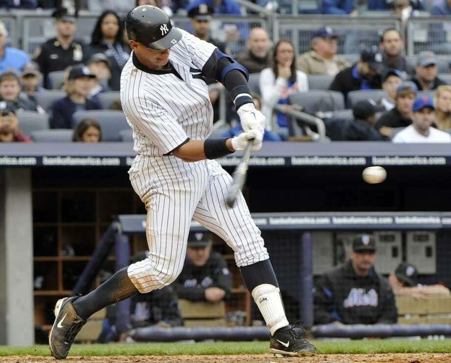 New York Yankees' Alex Rodriguez hits an RBI infield single during the seventh inning of an interleague baseball game against the New York Mets, Sunday, May 22, 2011, at Yankee Stadium in New York. The Yankees won 9-3. (AP Photo/Bill Kostroun) Photo: ASSOCIATED PRESS / AP2011