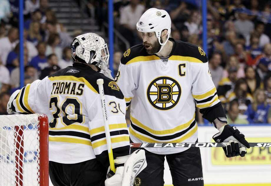 Boston Bruins defenseman Zdeno Chara (33) and goalie Tim Thomas (30) are shown during Game 4 against Tampa Bay Lightning of the NHL hockey Stanley Cup Eastern Conference final playoff series, Saturday, May 21, 2011, in Tampa, Fla. (AP Photo/Chris O'Meara) Photo: ASSOCIATED PRESS / AP2011