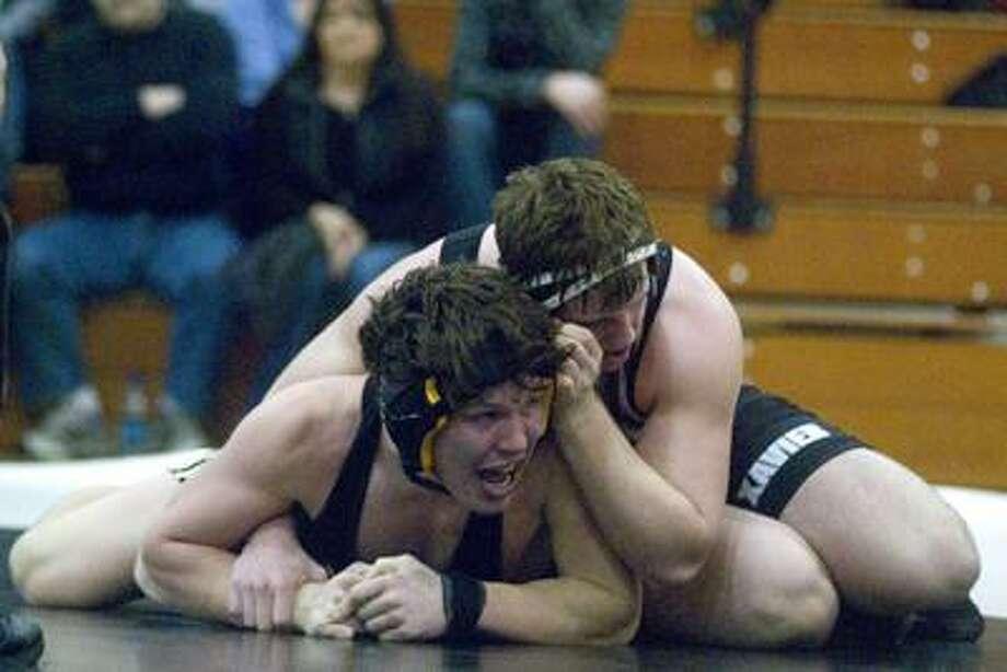 Xavier's Sean Marinan gains position on Hand's Nick Lawton Wednesday night at Xavier High School. (Max Steinmetz / Special to the Press)
