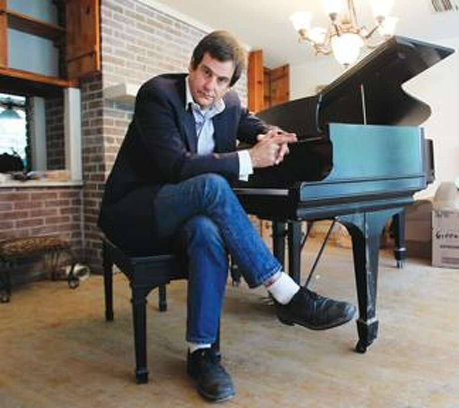In this May 20 photo, songwriter and musician Danny Tate sits at the piano he uses for composing in his Nashville, Tenn. home, which was damaged by recent floods. A court stripped Tate of control of his life -- taking away his right to make his own legal, financial and medical decisions -- at a last-minute hearing he didn't know was happening and didn't attend. With the drop of a gavel, the rock musician who'd written a top 10 hit and was making around $125,000 a year writing music for TV shows, was declared mentally disabled and in need of someone to manage his affairs. (AP) Photo: AP / AP