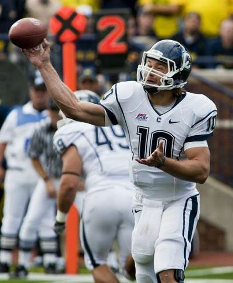 Connecticut quarterback Zach Frazer throws a pass in the second quarter of an NCAA college football game against Michigan, Saturday, Sept. 4, in Ann Arbor, Mich. (AP) Photo: ASSOCIATED PRESS / FR143848 AP
