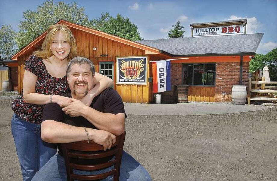 "Ernie and Cindy Piatti, owners of Hilltop BBQ & Steakhouse at 12 Ray Palmer Road in Moodus. To buy a glossy print of this photo and more, visit <a href=""http://www.middletownpress.com"">www.middletownpress.com</a>. (Catherine Avalone"