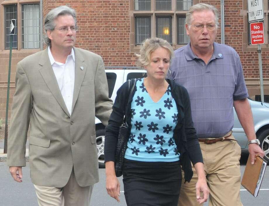 Dr. William Petit Jr., left, and family members arrive at court. Melanie Stengel/Register
