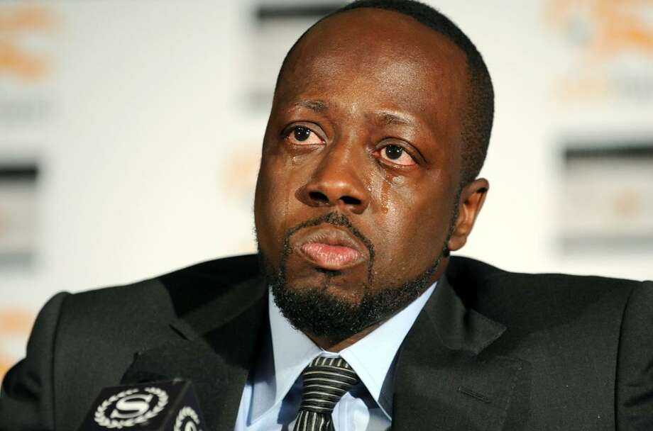 Haitian-born musician Wyclef Jean is overcome with emotion while discussing his recent visit to earthquake-stricken Haiti and how is organization, Yele Haiti, is helping with relief efforts, Monday in New York. (AP) Photo: AP / FR81453 AP