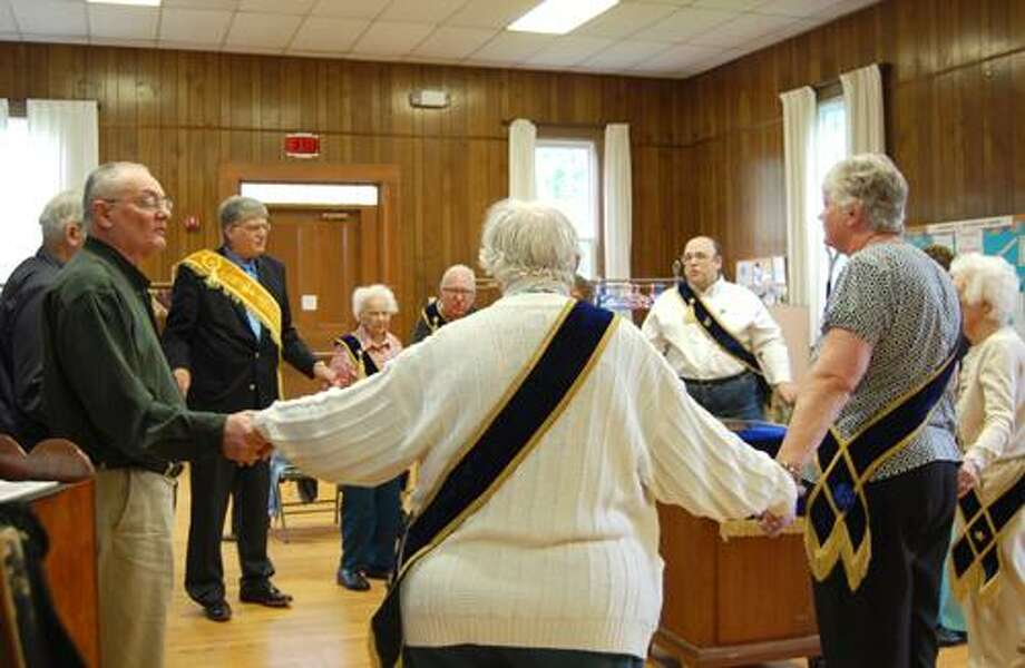 Claire Michalewicz I The Middletown Press Members of the Westfield Grange #50 sing 'Auld Lang Syne' one final time, after they voted to turn over their charter to the state grange. The Westfield chapter had been active since 1886, but decided to close down because of declining membership.