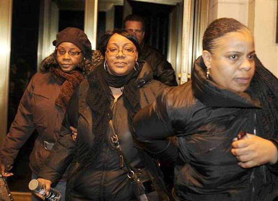 Joy White, center, birth mother of Carlina White, exits a hotel with two unidentified women Thursday, Jan. 20, 2011 in New York. Carlina White was abducted in 1987 when she was 19 days old. (AP Photo/Stephen Chernin) Photo: ASSOCIATED PRESS / AP2011