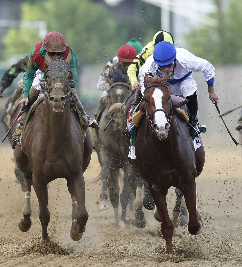 Shackleford, right, ridden by Jesus Castanon, works down the stretch in front of Animal Kingdom, left, ridden by Mike Smith, in front of the rest of the pack during 136th Preakness Stakes horse race at Pimlico Race Course, Saturday, May 21, 2011, in Baltimore. Shackleford won the race. (AP Photo/John Bazemore) Photo: ASSOCIATED PRESS / AP2011