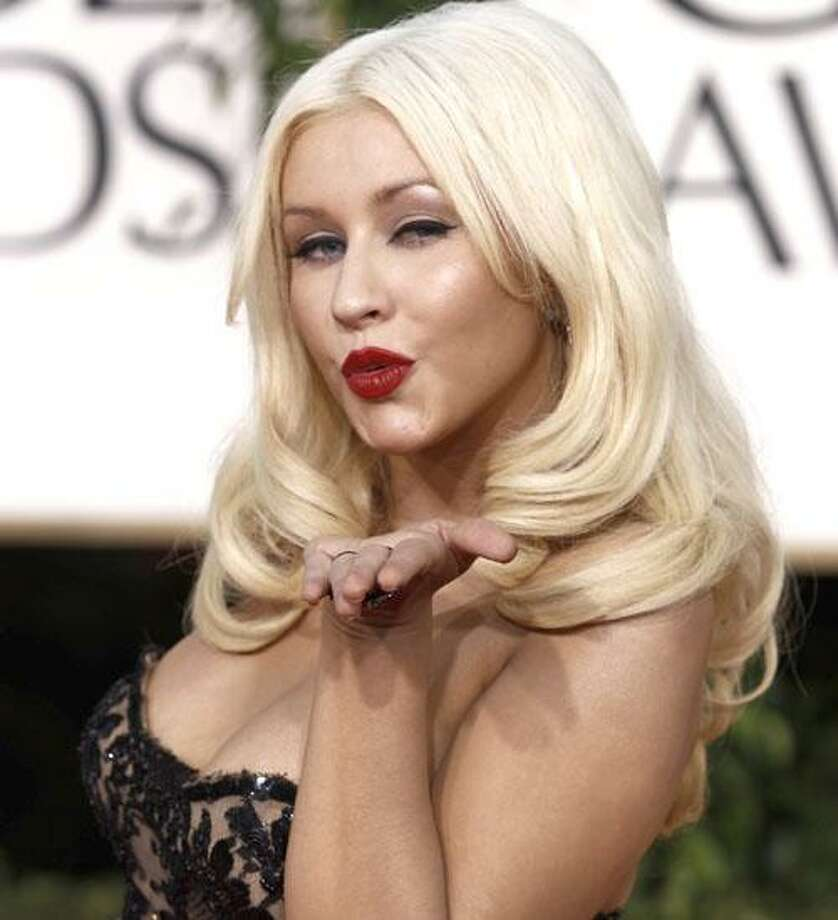 FILE - In this Jan. 16, 2011 file photo, singer Christina Aguilera arrives for the Golden Globe Awards in Beverly Hills, Calif. Aguilera will sing the national anthem at the Super Bowl in Texas on Feb. 6. (AP Photo/Matt Sayles, file) Photo: ASSOCIATED PRESS / AP2011