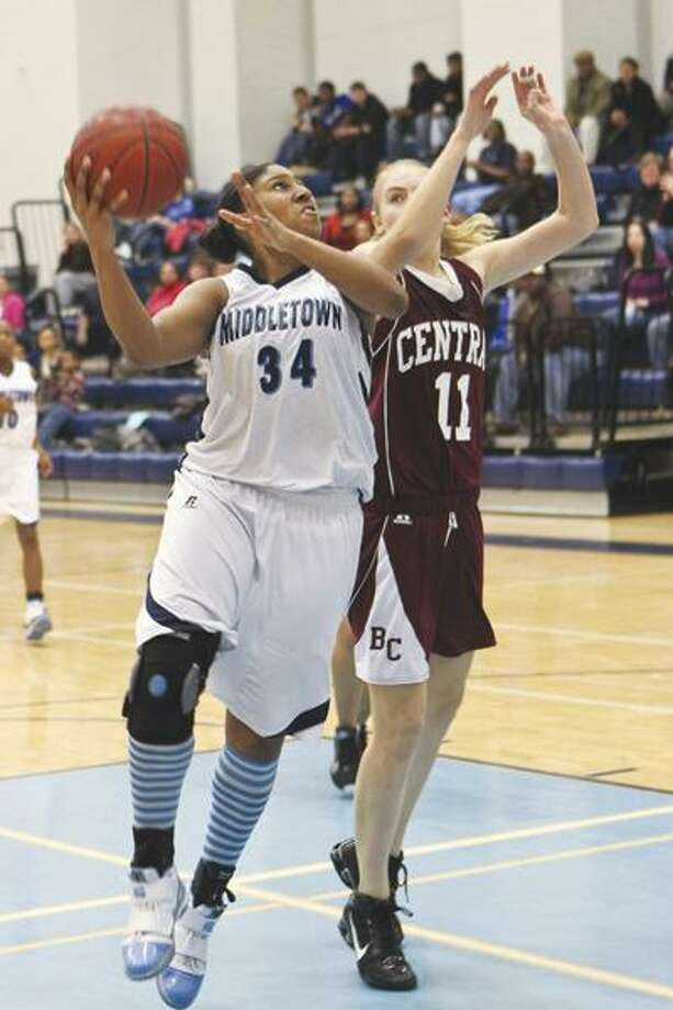 Raven Wright-James (34) goes up for a shot against a Bristol Central defender. (Photo courtesy of Sandy Aldieri)