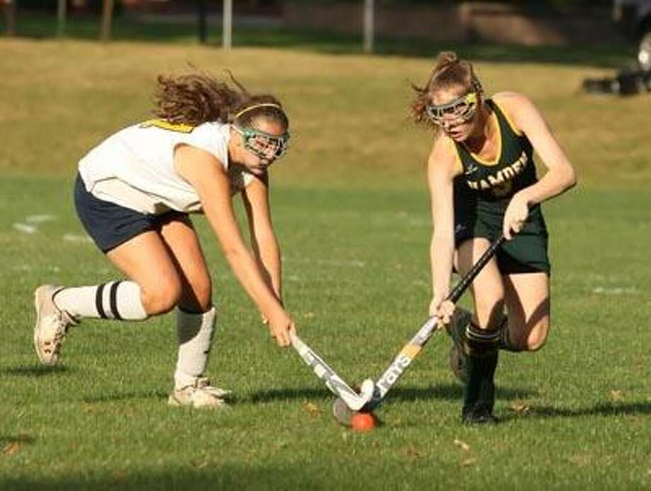 Mercy's Krissy Holt, left, and Hamden's Bridget O'Neil battle for control of the ball Thursday at Mercy High School in Middletown. (Todd Kalif