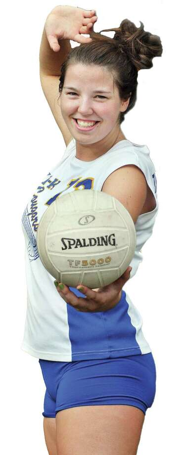"""Special to the Press 09.15.11 Haddam-Killingworth's Ana Tarbetsky nails the final point in H-K's Thursday night girls' volleyball match with Hale-Ray. H-K won, 3-0. To buy a glossy print of this photo and more, visit <a href=""""http://www.middletownpress.com"""">www.middletownpress.com</a>."""