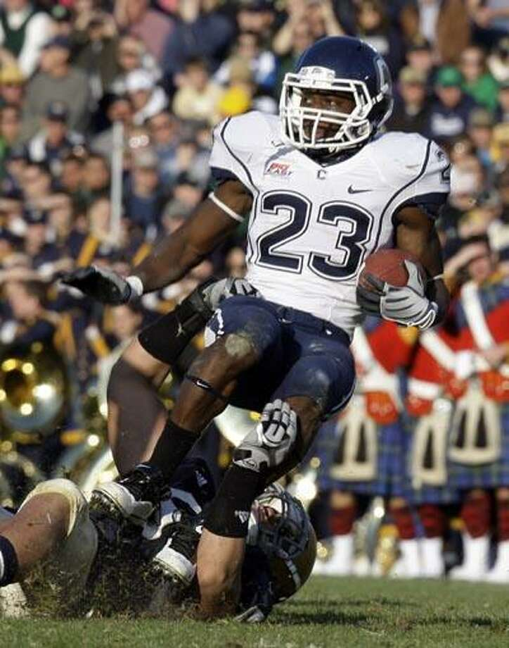 Connecticut running back Jordan Todman (23) is tackled by Notre Dame linebacker Manti Te'o during the first quarter of an NCAA college football game in South Bend, Ind., Saturday, Nov. 21, 2009. (AP) Photo: ASSOCIATED PRESS / AP2009