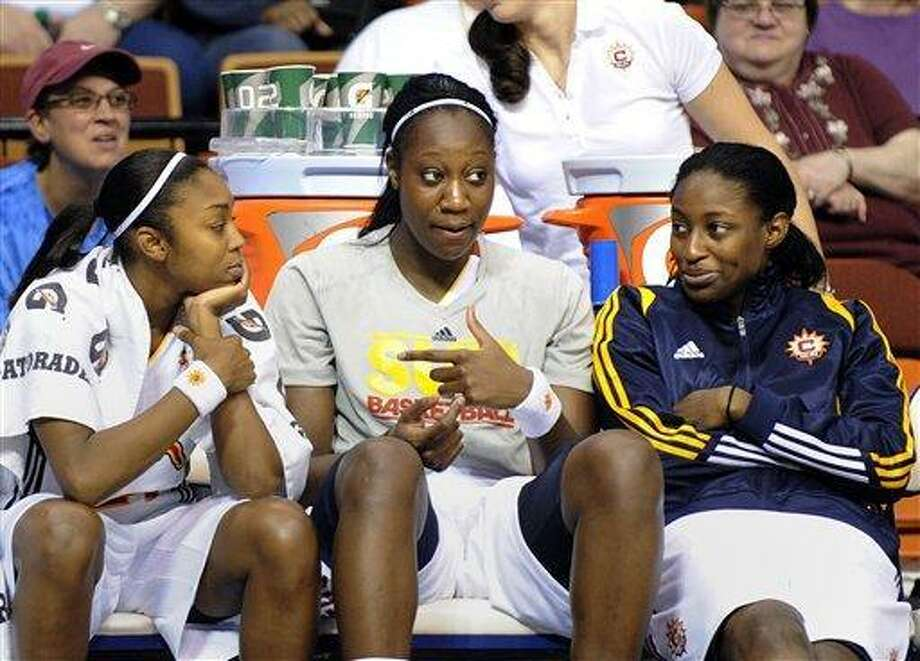Former Uconn players and current members of the Connecticut Sun, from left, Renee Montgomery, Tina Charles and Kalana Greene. Charles was awarded the Role Model of the Year by the Middlesex Chamber of Commerce on Friday.(AP Photo/Fred Beckham) Photo: AP / FR153656 AP