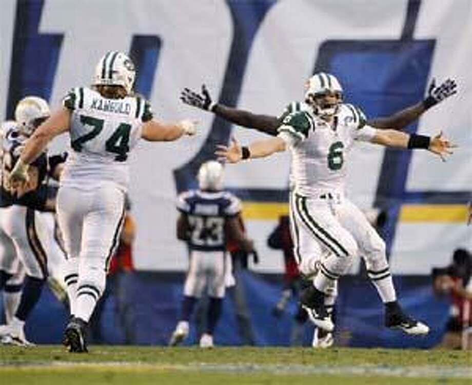 (AP) Jets center Nick Mangold (74), quarterback Mark Sanchez (6) and running back Tony Richardson (49) celebrate following a touchdown run by running back Shonn Greene in the second half of their 17-14 win over the San Diego Chargers Sunday in San Diego. The Jets will face the Colts in Indianapolis next Sunday for a chance to go to the Super Bowl.