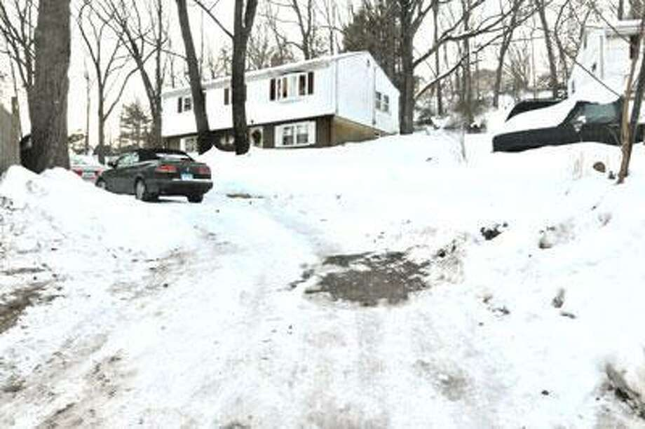 The body of Denise O'Hara, 50, was found in this driveway on Upper State Street in North Haven. (Melanie Stengel/Register)