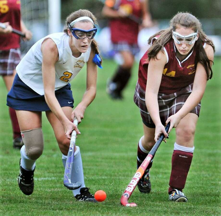"""The Middletown Press  9.20.11  Mercy senior Gabriela Orlando battles for possession with Sheehan captain Madison Mizenko during the second half of a match Tuesday afternoon in Middletown. Mercy defeated Sheehan 2-1 in a sudden death. To buy a print of this photo and more, visit <a href=""""http://www.middletownpress.com"""">www.middletownpress.com</a>"""