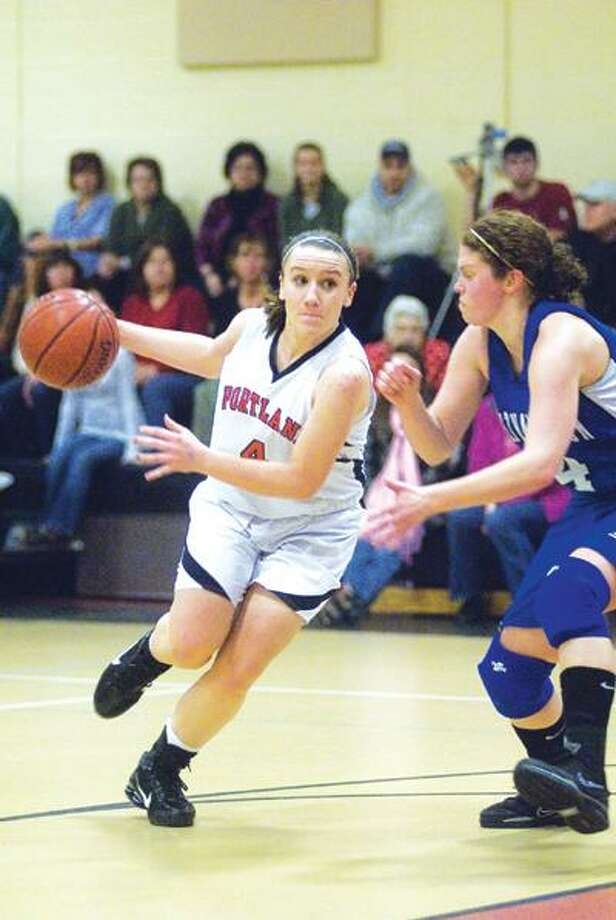 Portland's Lindsey Dionne of Portland drives past Lindsey Kimball of East Hampton last Tuesday night at Portland High School. The Highlanders have struggled since starting the season 9-0, losing to of its last three, including Monday's game against Morgan. (Max Steinmetz / Special to the Press)