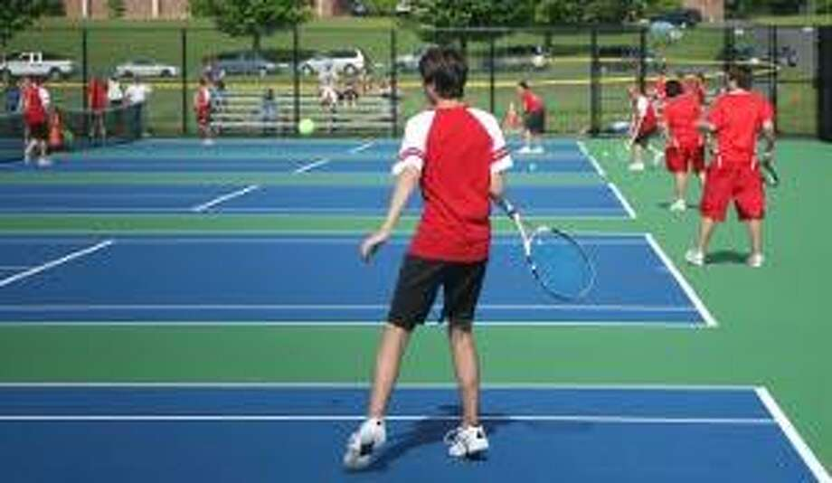 TODD KALIF/Press Correspondent Valley's James Baker focuses on a forehand on Coginchaug's new blue and green tennis courts in Coginchaug's match with Valley on May 20. Valley won, 5-2. For a glossy print of this photo and more, visit www.middletownpress.com