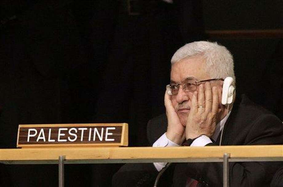 Palestinian President Mahmoud Abbas holds his hands to his face as U.S. President Barack Obama speaks during the 66th session of the General Assembly at United Nations headquarters Wednesday, Sept. 21, 2011.  (AP Photo/Seth Wenig) Photo: ASSOCIATED PRESS / AP2011