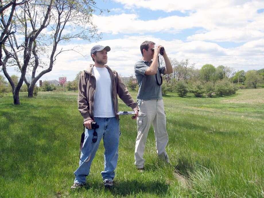 Scott Kruitbosch, left, and Twan Leenders of the Connecticut Audubon Society were looking for shorebirds  at Stratford Point. (Jim Shelton/Journal Register News Service)
