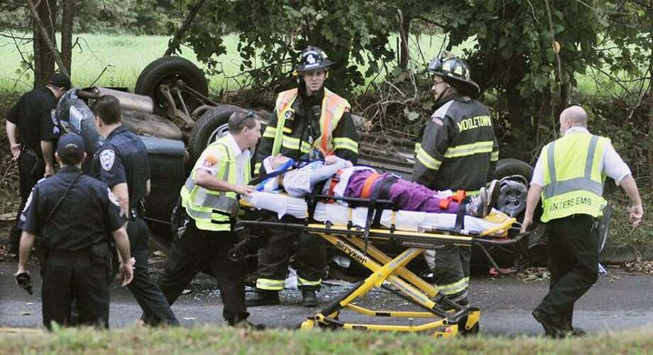 The Middletown Press  9.20.11  Middletown police take measurements at the scene where a woman driving a Hyundai Elantra  was involved in a single vehicle rollover at the intersection of Randolph and Gleeson Road in Middletown shortly before 3:30 p.m.  The woman  was transported by ambulance to Middlesex Hospital and will be treated for non-life threatening injuries, according to police. One woman was taken to Hartford Hosipital where she will be treated for non-life threatening injuries, according to police. The car landed on its roof.