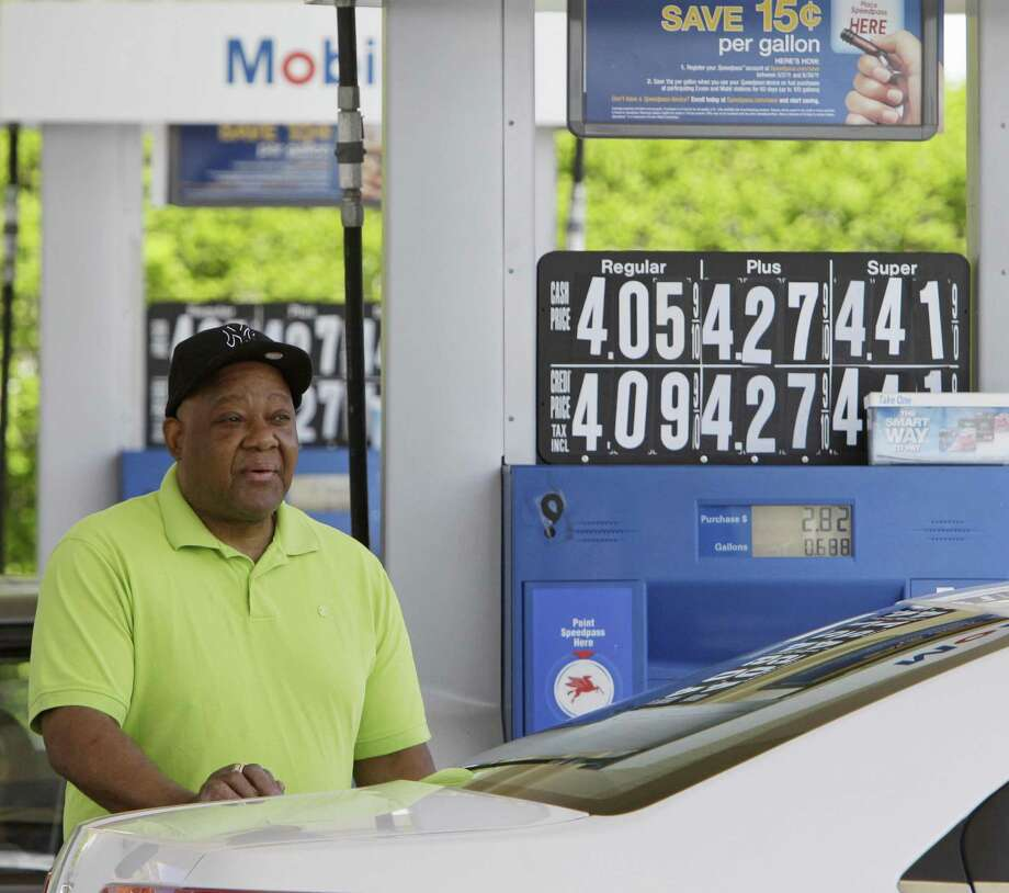 Elijah Willingham of Albany, N.Y. pumps gas at a station in Menands, N.Y., Wednesday. New York, Indiana, Illinois and New Hampshire are among the first states talking about temporarily suspending part or all of the state and local taxes that can add 14 cents to nearly 50 cents to a gallon of gas. (AP Photo/Mike Groll) Photo: AP / AP