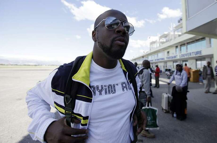 Haiti's Musician Wyclef Jean arrives at the airport in Port-au-Prince on Wednesday, the day after a 7.0-magnitude earthquake hit his country. (AP)
