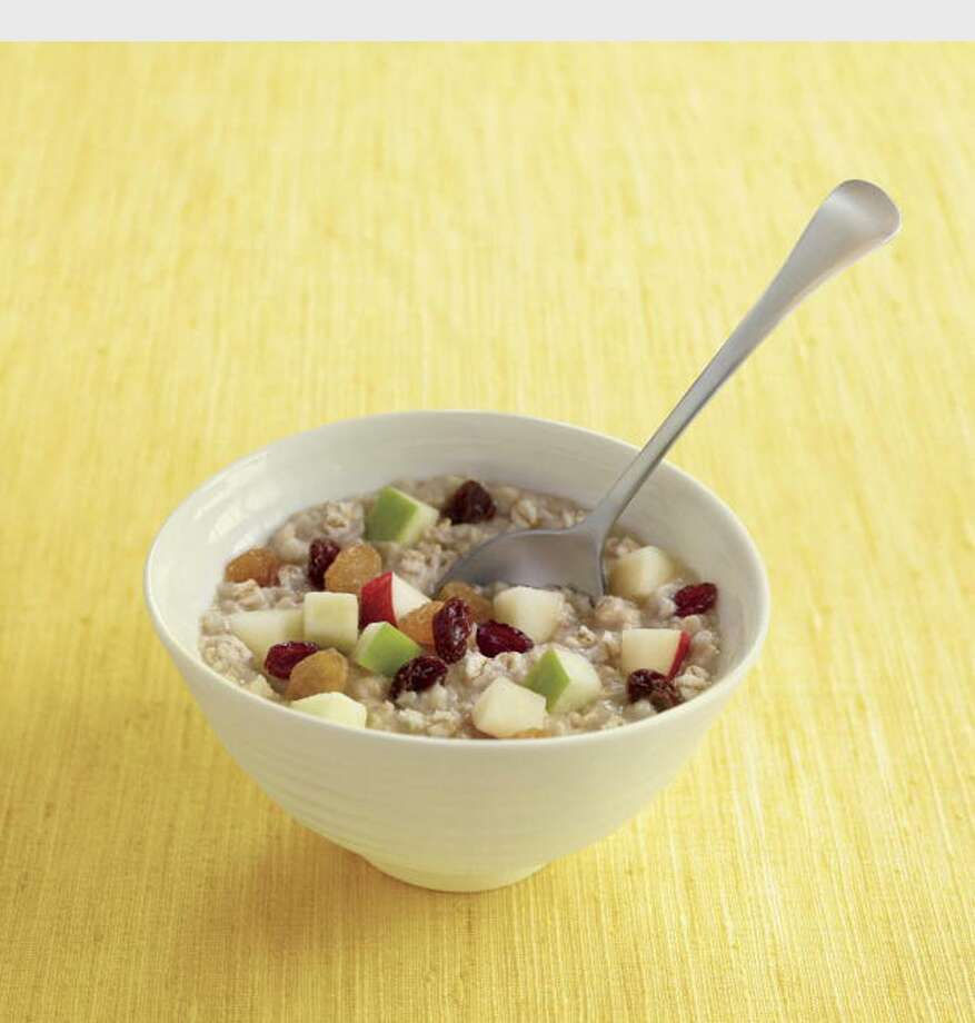 Taste the sweet harmony of flavors in McDonald's new Fruit & Maple Oatmeal, prepared with 100 percent natural whole grain oats, light cream and brown sugar, and topped with diced, fresh red and green apples, tangy dried cranberries and two types of raisins. Available any time of the day, Fruit & Maple Oatmeal is available with or without brown sugar.  (PRNewsFoto/McDonald's) Photo: PR NEWSWIRE / MCDONALD'S