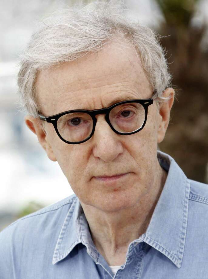 """In this May 11, file photo, director Woody Allen poses during a photo call for Midnight in Paris, at the 64th international film festival, in Cannes, southern France. A new play of three one-act comedies """"Relatively Speaking,"""" by  Ethan Coen, Elaine May and Woody Allen will arrive on Broadway this fall. It will be directed by John Turturro. (AP Photo/Joel Ryan, file) Photo: AP / AP2011"""