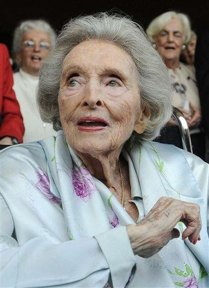 "FILE - In this May 27, 2009 file photo, Dolores Hope, the widow of legendary comedian Bob Hope, looks on as partygoers sing ""Happy Birthday"" to her during her 100th birthday party in Los Angeles. Hope, who was married to Bob Hope for 69 years and sang at his shows, died Monday, Sept. 19, 2011 of natural causes at home in Los Angeles. She was 102. (AP Photo/Chris Pizzello, file) Photo: AP / AP2009"