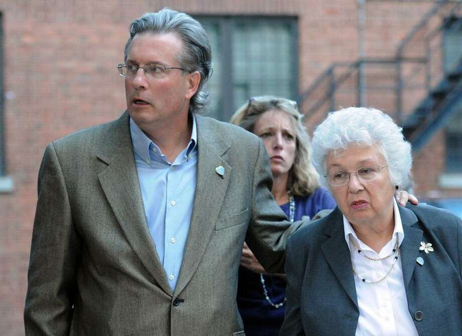 New Haven-- Dr. William Petit Jr. walks toward Superior Court with his mother, Barbara Petit, and his sister Johanna Chapman for the first day of the Joshua Komisarjevsky trial.  Peter Casolino/New Haven Register  9/19/11