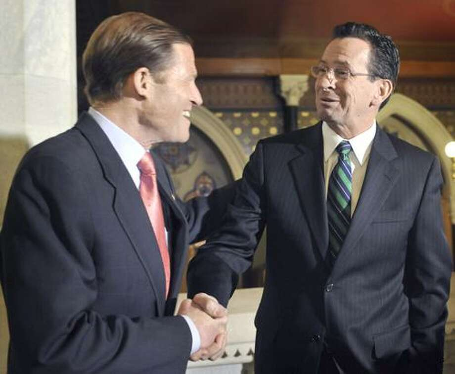 Connecticut Gov. Dannel P. Malloy, right, shakes hands with U.S. Sen. Richard Blumenthal, D- Conn., outside office at the Capitol in Hartford, Conn., Tuesday, Jan. 18, 2011. Malloy and Blumenthal met to discuss ways in which they plan to work together over the course of the coming years. (AP Photo/Jessica Hill) Photo: AP / AP2011