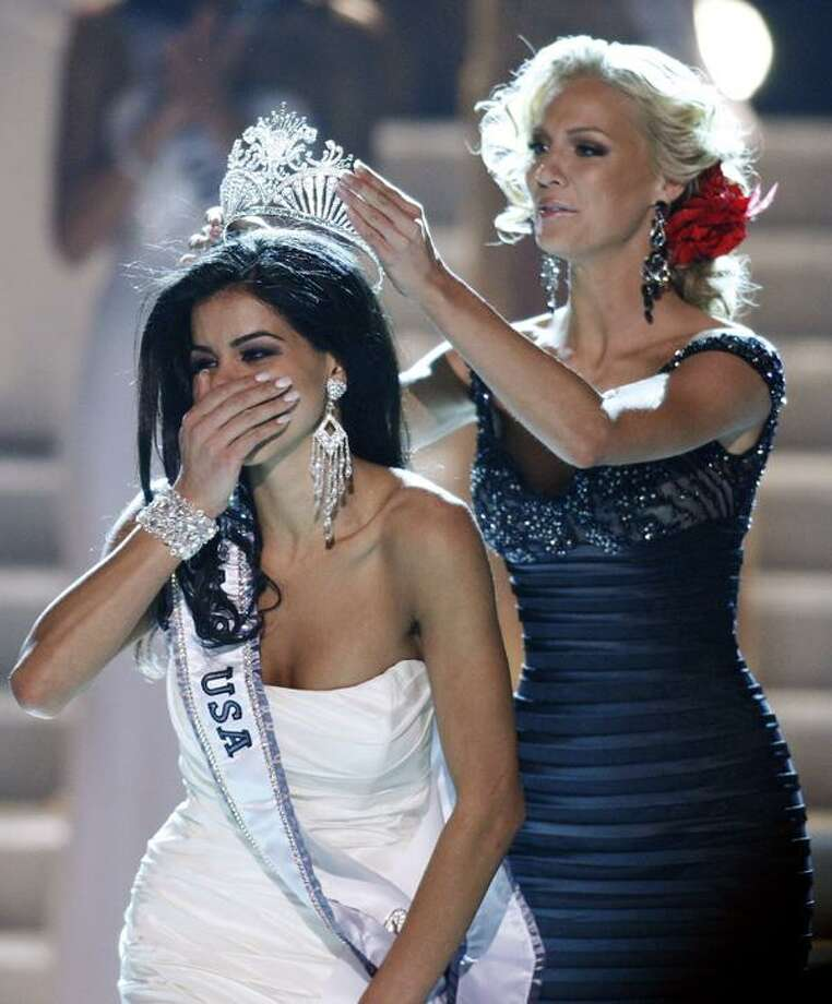 Miss Michigan Rima Fakih, left, reacts as she is crowned Miss USA 2010 by Kristen Dalton, Miss USA 2009, Sunday in Las Vegas. (AP) Photo: ASSOCIATED PRESS / AP2010