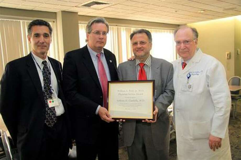 Hospital physician Anthony Ciardella, M.D., third from left in photo, has received the first annual William A. Petit, Jr., M.D., Physician Service Award.