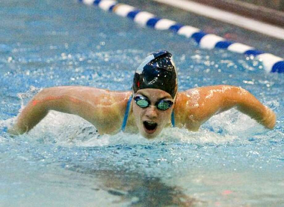 Middletown High School senior swim captain Christina Nowak swimming the Butterfly during a meet against Conard High School Tuesday night at Middletown High School. The Blue Dragons lost to Conard, 96-80. (Sandy Aldieri